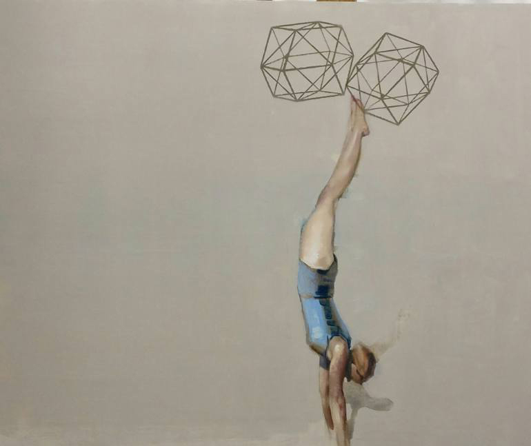 Woman holding geometric forms with her feet.