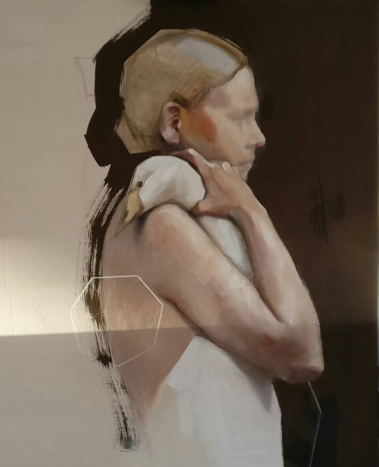 Profile female portrait holding a duck.
