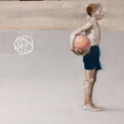 Young boy holding a ball full body portrait.