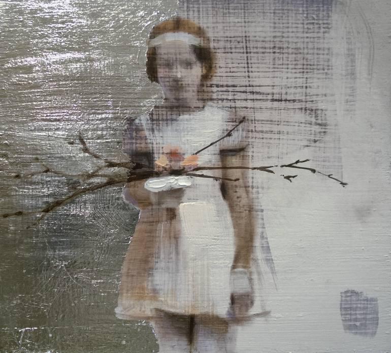 Girl holding wood portrait.