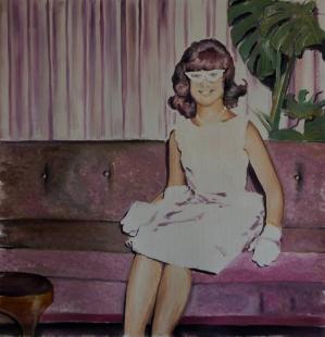 Woman sit on a a sofa.
