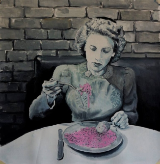 Woman eating pink spaghetti.