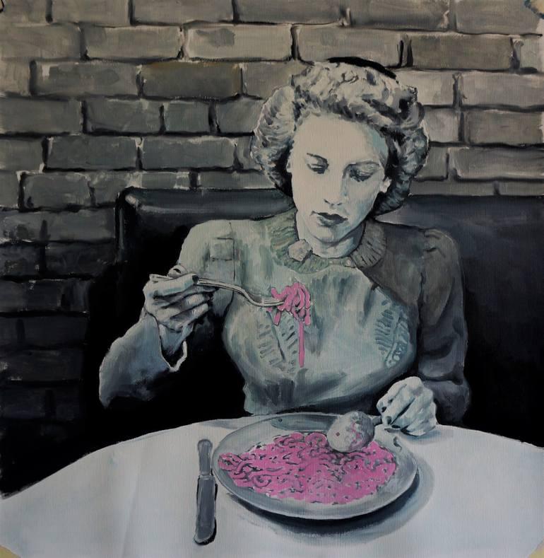 Woman eating pink spaghetti.