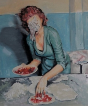 Defaced woman making pizza.