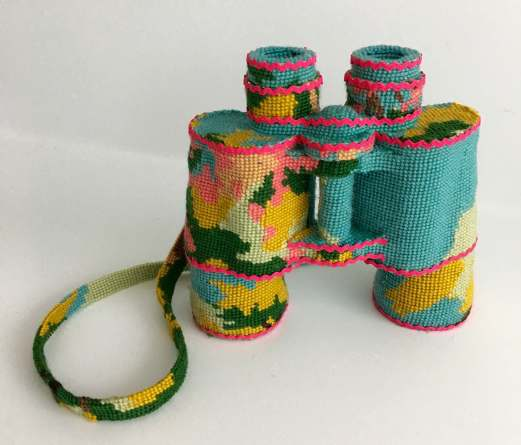 Still life photo of a binocular entirely covered with a textile.