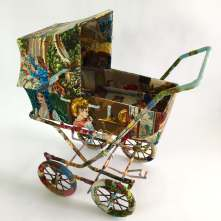 Still life photo of a stroller entirely covered with a textile.