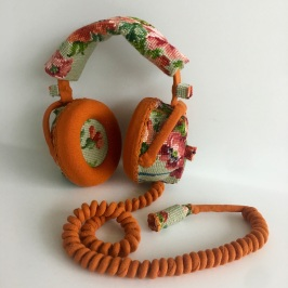 Still life photo of headphones entirely covered with a textile.