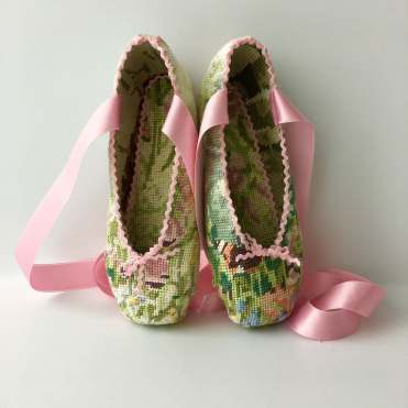 Still life photo of a ballerina shoes entirely covered with a textile.