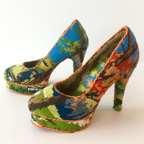 Still life photo of shoes entirely covered with a textile.