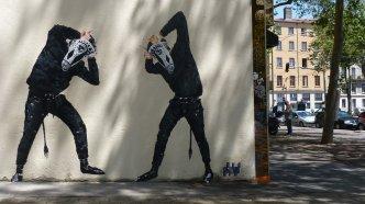 Two masked men illustration.