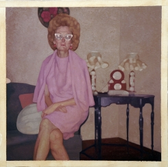 Woman sit on the sofa with a pink dress portrait.