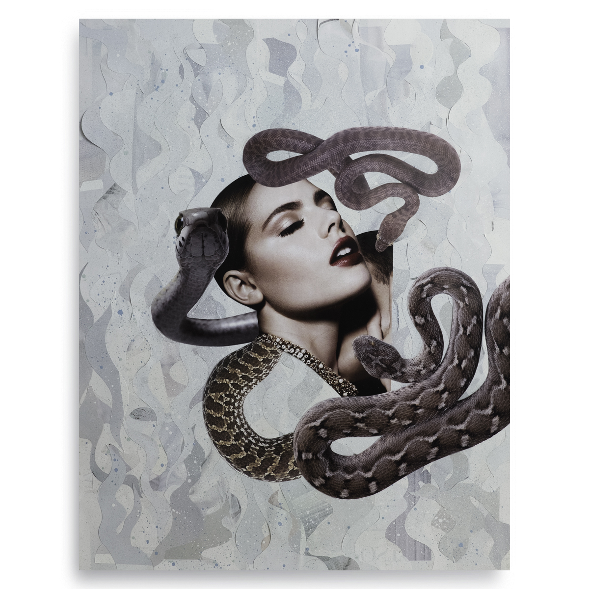 Female head surrounded by snakes.
