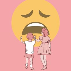 Two kids seen from their back touching a giant emoji face.