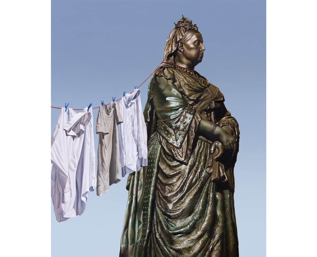 Monument of queen Victoria painting with clothes hanging aside her.