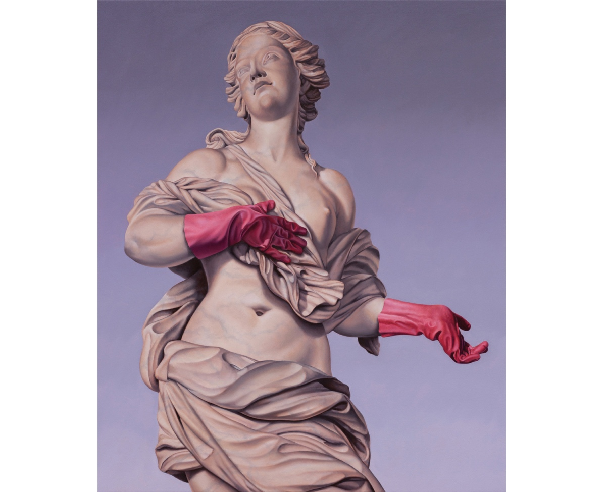 Female monument painting while wearing pink rubber gloves.