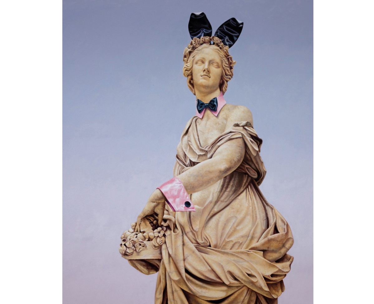 Female monument painting wearing bunny ears.