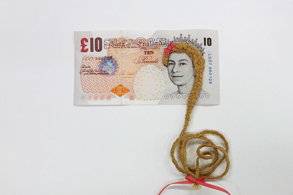 Embroidered hair of a banknote portrait.