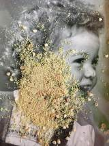 Sprinkle of dried flowers of a vintage baby photo.