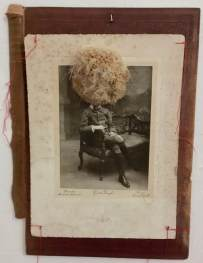 Dried flower over a vintage boy photograph.