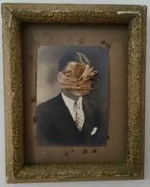 Dried flower over a vintage make portrait.