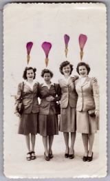 Dried pink petals over a vintage photo of a group of women.