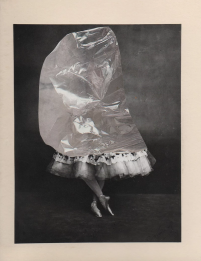 Female dancer with half body covered with plastic.