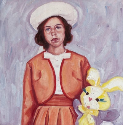 Portait of elegant baby girl holding a plush bunny.