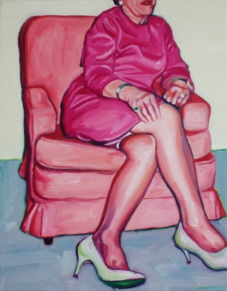 Elegant woman sit on a couch portrait.
